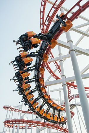 The rollercoaster with player in amusement park.
