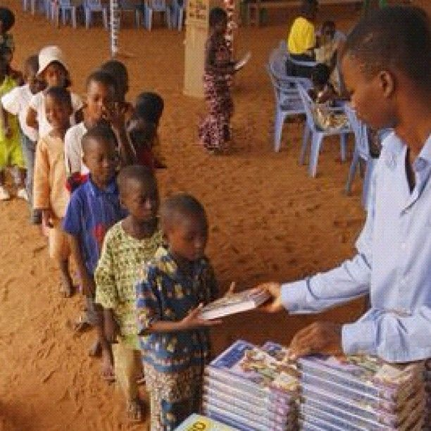 Sharing the Word of God with the next generation. Free Bible distribution in Togo....can you imagine kids in America lining up to receive bibles?