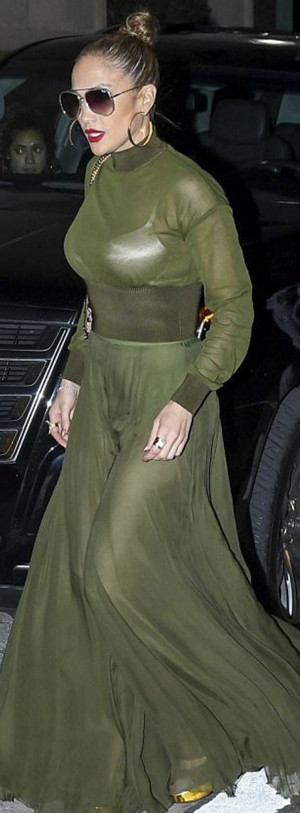 Who made Jennifer Lopez's sunglasses, green sheer top, gold jewelry, maxi skirt, and gold platform pumps?