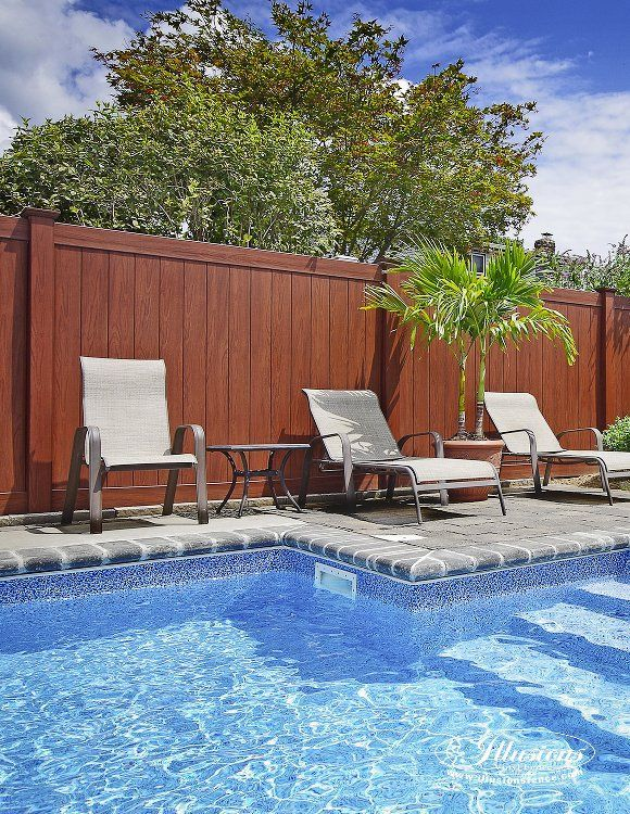 This awesome wood grain vinyl pool fence is the Grand Illusions Vinyl WoodBond Rosewood (W104) V300-6W104 6'H x 8'W Tongue and Groove PVC vinyl privacy fence from Illusions Vinyl Fence. You can create your own backyard oasis with these amazing fencing panels. This particular backyard is smack dab in the middle of the suburbs of Long Island, New York. You'd never know it though. It looks like a tropical paradise. Pretty amazing what you can do with the right fence. #illusionsfence