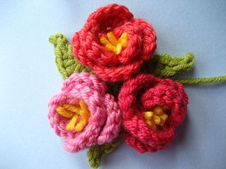 These sweet little flowers can be worked in any weight thread. Done in finer threads, they make a delicate applique for clothing and smaller items. They make a lovely accent for the corners of a little girl's blanket. The pattern is written in UK crochet terms, so, as stated at the beginning of the pattern: