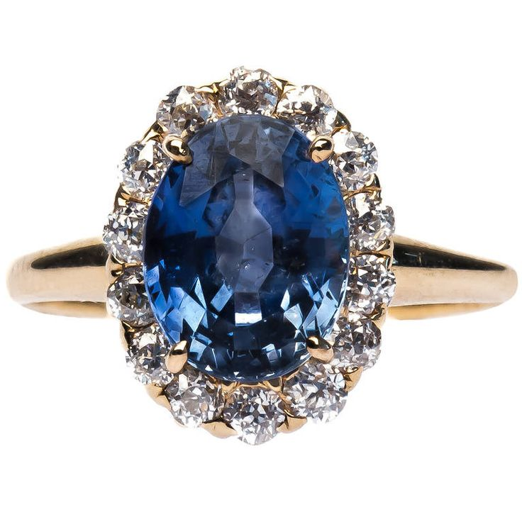 Lovely Victorian Sapphire Diamond Engagement Ring. Victorian era 14k yellow gold engagement ring centering a beautiful natural oval sapphire gauged at 3.10ct with a slightly purplish blue hue and lightly saturated. Bayside is framed by a lovely halo of fourteen Old European cut diamonds totaling approximately 0.40ct and is complete with a simple, lightly polished, 14k yellow gold shank.