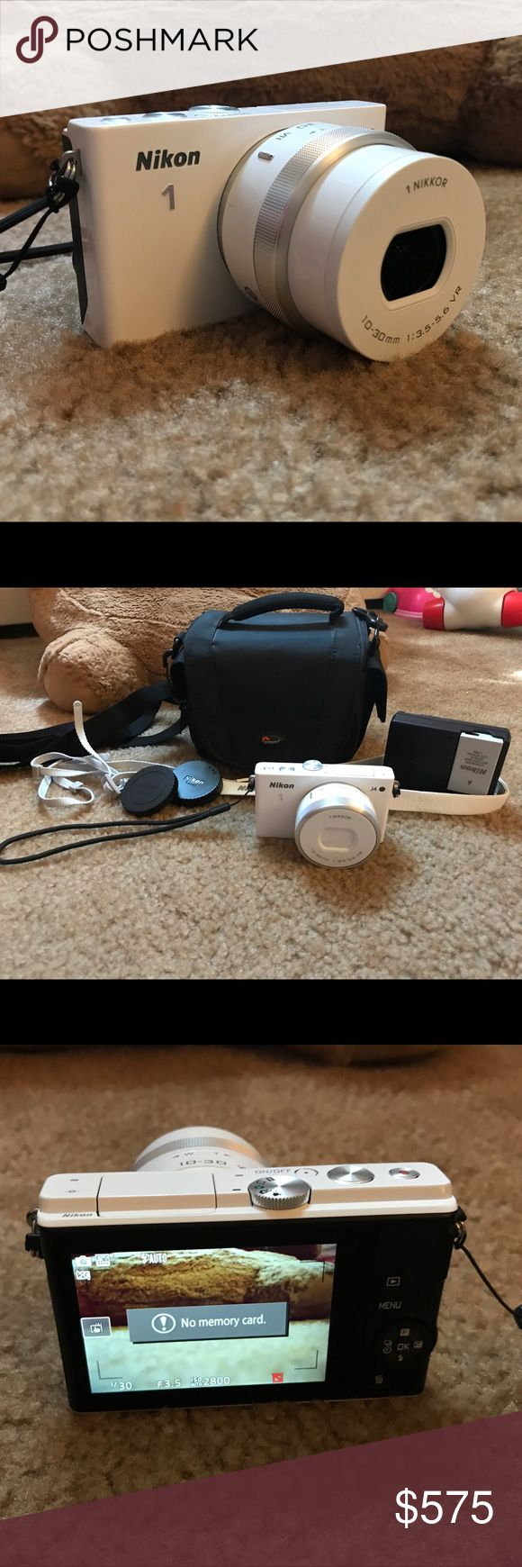 Nikon 1 J4 Digital Camera 📸 This camera was only used ONCE! It is in amazing condition! Included in this is the Nikon 1 J4 camera body, the Nikkor 10-30 mm detachable lens (you see attached to camera in photos), lens covers, recharble battery & port, the neck strap & the camera bag. You can see on Amazon the camera body with the lens is sold for $600 (shown in photo). Due to the price, I will film this being packaged to whoever purchases it for assurance. This camera needs someone who will…