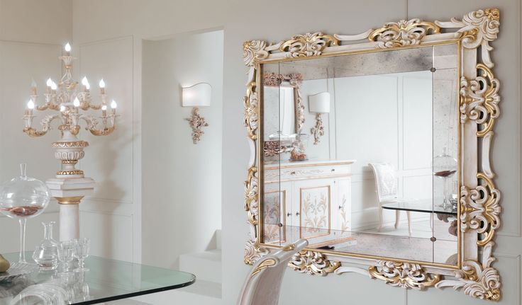 Carved mirror frame decorated with gold leaf and ivory