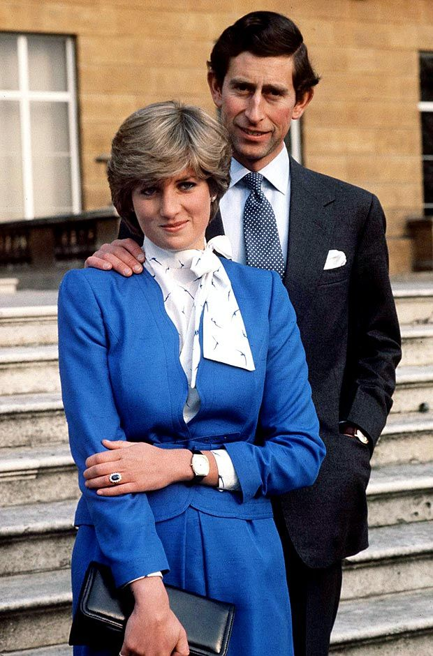 """Prince Charles and Diana smiled outside Buckingham Palace after announcing their engagement on Feb. 24, 1981. When asked by the press if they were in love, Diana replied """"Of course,"""" while Charles infamously retorted, """"Whatever love is."""""""