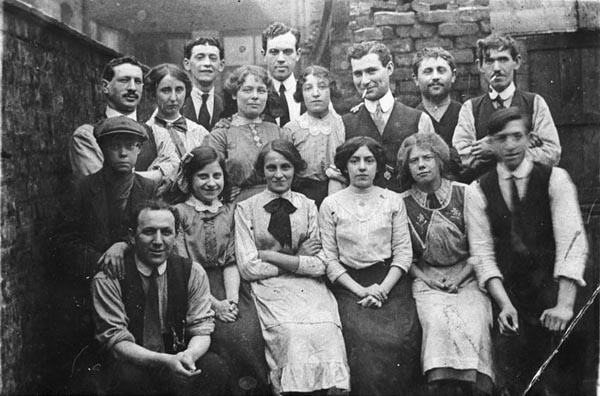 Group of (mostly Jewish) workers from Flacks tailoring workshop in Salford, c.1910.