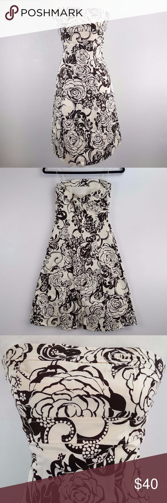"""B.Smart Ivory & Brown Roses Strapless Dress 3/4 This B. Smart dress is a pretty cream with dark chocolate brown rose pattern in a woman's size 3/4. See measurements for your best fit.  Perfect for Summer! Clear straps allow for wearing strapless, or with straps for support 97% Cotton, 3% Spandex, Stretch fabric content provides a superior fit $70 MSRP CONDITION: Brand new with tags MEASUREMENTS: all taken with garment laid flat  bust from armpit to armpit: 13x2=26"""" waist: 14""""x2=28"""" total…"""