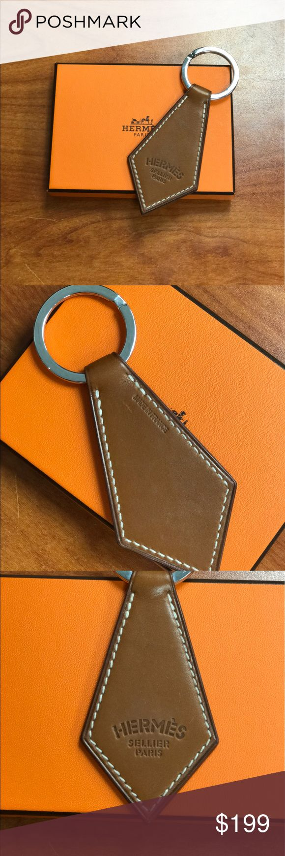 "Hermes Tab Key Ring Hermes Tie shape Tab Key Ring in Swift calfskin with ""Hermes Sellier Paris"" print. This item is in excellent/pristine condition. Comes with original box. Hermes Accessories Key & Card Holders"