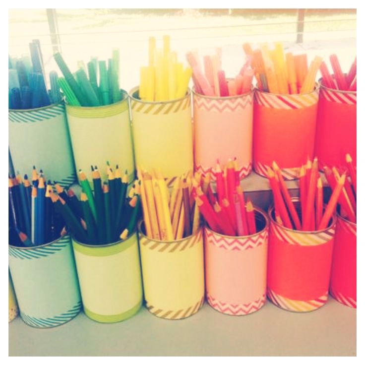 This is my pencil storage system, it's so colorful! I recycled tin cans and wrapped them in colored paper and washi tape :)