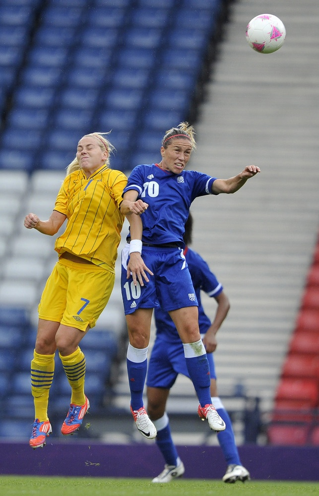 Camille Abily of France & Lisa Dahlkvist of Sweden battle for the ball during the Women's Football Quarter Final match between Sweden and France, on Day 7 of the London 2012 Olympic Games at Hampden Park on August 3, 2012 in Glasgow, Scotland.