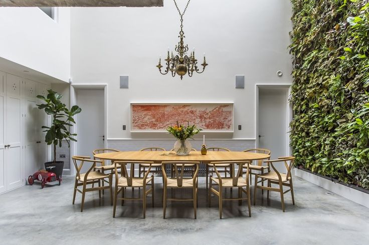 Gravity Home: Dining space with a wall of greenery in a Spectacular London Loft