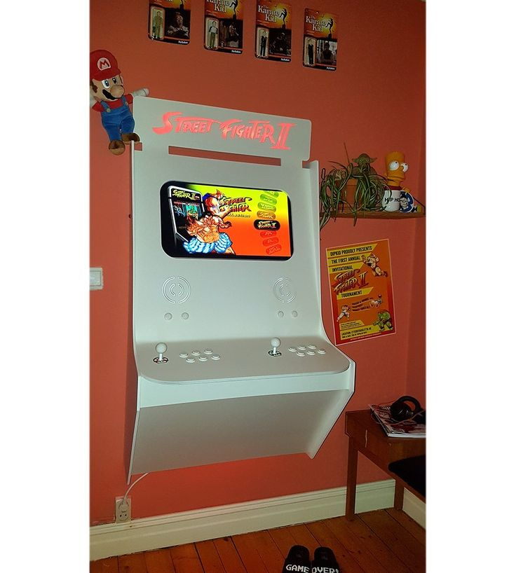 Wall mounted Arcade cabinet.