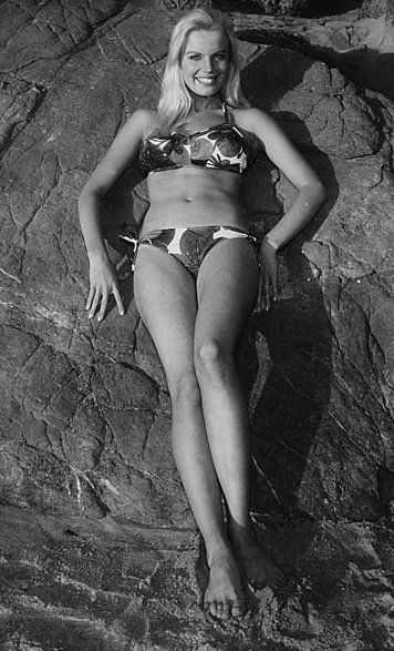 marta kristen judy from lost in space sunning on a space