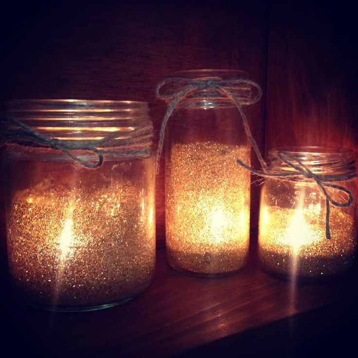 DIY gold glitter jar candle holders - wedding decor for hire at Lace & Twine www.facebook.com/LaceTwine Just paint the inside of the jar with glue, then add glitter. Shake it around in the jar until it covers all the glue & dry. SO EASY!