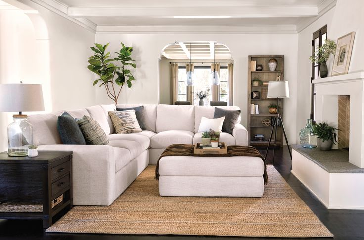 Bowen Sectional & Ottoman. This cream white sectional is spacious enough for sprawling out with deep down-blend cushions, soft enough for sinking in and curling up. Find this and more versatile styles in our Casual Living Collection. #CasualLiving #LivingSpaces
