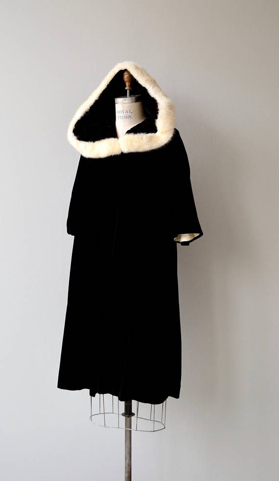 Vintage 1950s black velvet opera coat with white faux fur trim, 3/4 sleeves, plushy white lining and no closures, meant to be worn open.  --- M E A S U R E M E N T S ---  fits like: small/medium shoulder: 20 bust: 42 waist: free hip: 46 sleeve: 14 length: 41 brand/maker: n/a condition: excellent, one discoloration on lining  ★ layaway is available for this item  ➸ More vintage coats http://www.etsy.com/shop/DearGolden?section_id=5800175  ➸ Visit th...