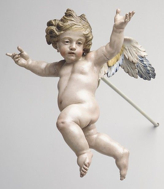 "'Cherub' (second half 18th century) from the ""Christmas Tree & Neapolitan Baroque Crèche."" Polychromed wood, 7 in. via the Met, NYC"
