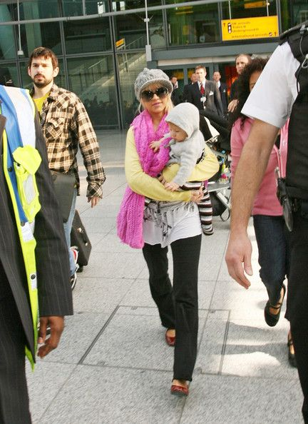 Christina Aguilera Photos - Christina Aguilera with husband Jordan Bratman, and son Max Liron (b. January 12, 2008) arrive at Heathrow airport in London, England . - Christina Aguilera and family arrive in London
