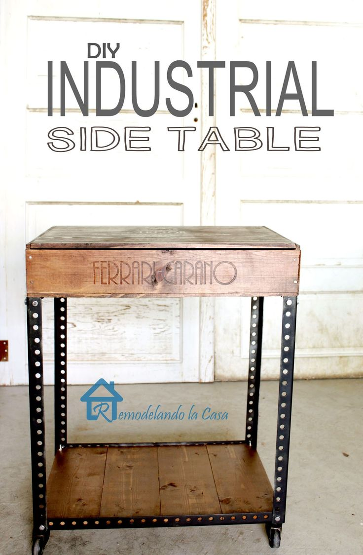 They used metal strips from an old garage door and crates to build this table! - Remodelando la Casa: DIY Industrial Side Table