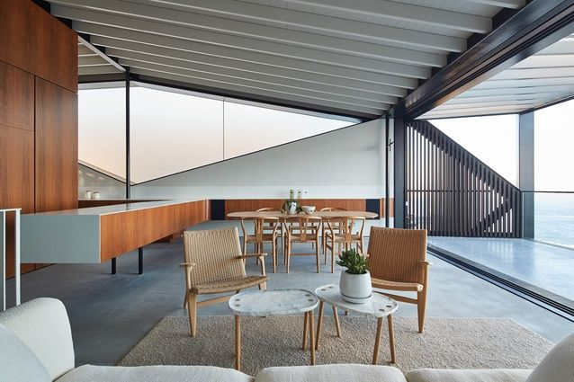 """Expressed purlins give the home a """"beach feel"""" and the frosted glazing allows for diffused light without compromising privacy."""