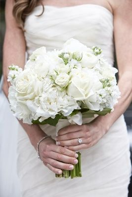 Classic Bridal Bouquet in White Photography: KingenSmith Read More: http://www.insideweddings.com/weddings/modern-wedding-with-soft-color-palette-and-personalized-details/792/