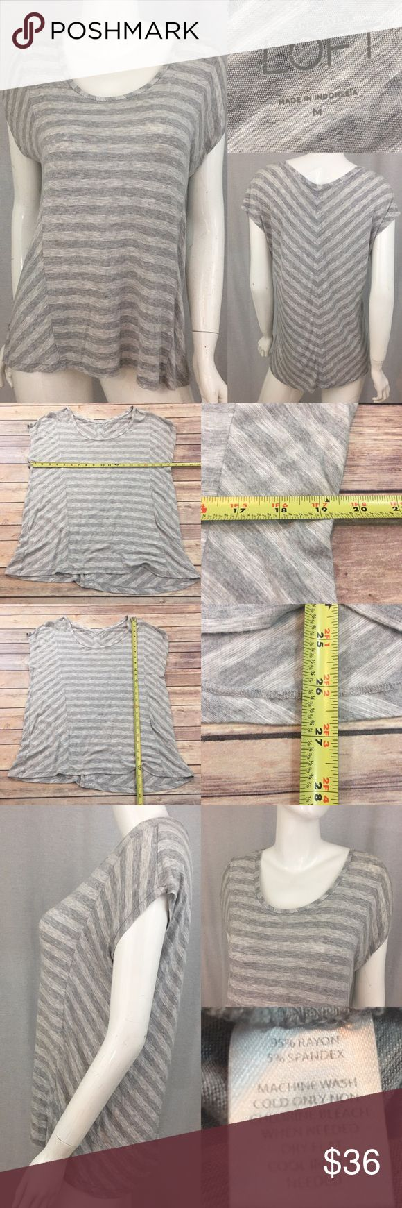 🍭Size Medium LOFT Gray Striped Short Sleeve Top Measurements are in photos. Normal wash wear, mild piling, no other flaws.   I do not comment to my buyers after purchases, do to their privacy. If you would like any reassurance after your purchase that I did receive your order, please feel free to comment on the listing and I will promptly respond. I ship everyday and I always package safely. Thanks! LOFT Tops