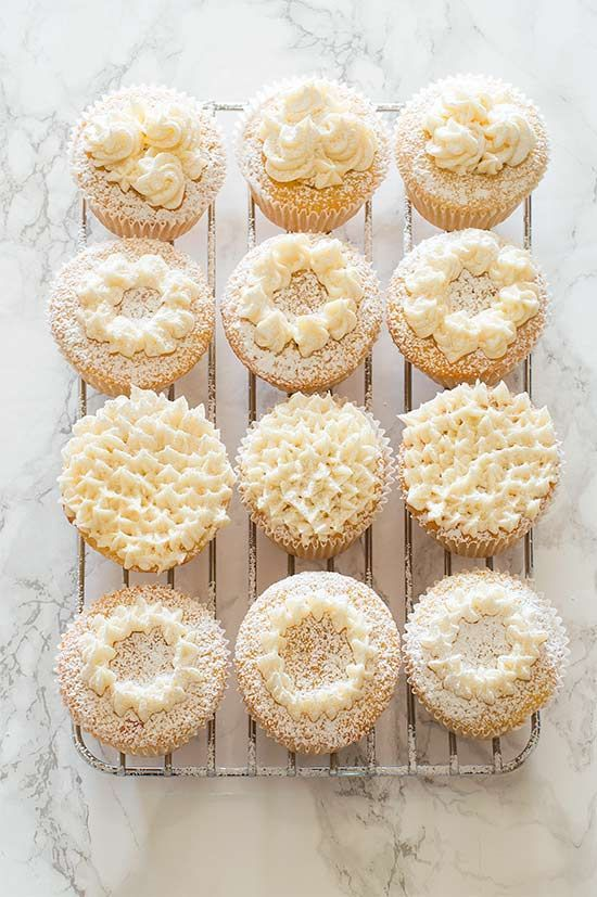Victoria Sponge Cupcakes - Adorable light and airy sponge cupcakes filled with raspberry jam and topped with buttercream frosting. Recipe includes nutritional information and small-batch instructions. From http://BakingMischief.com