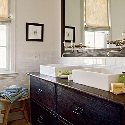 Coastal Living: Overmount double bathroom sinks, black chest vanity, linen roman…