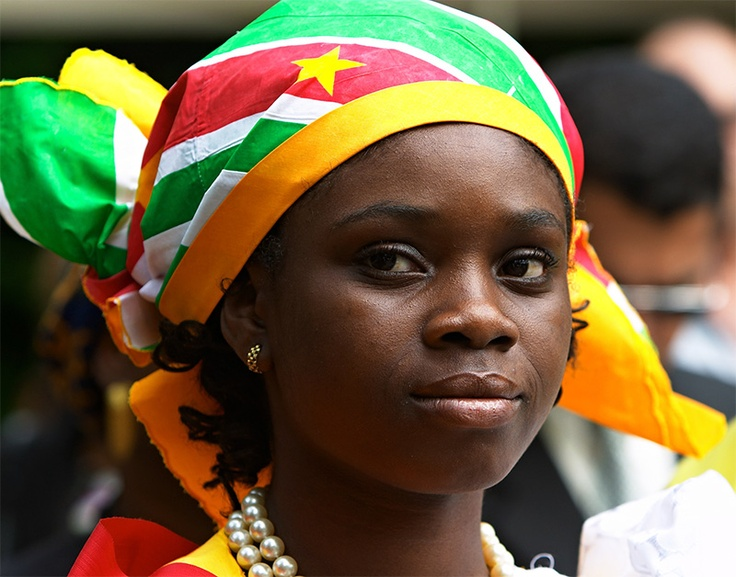 A young beautiful woman from Suriname wearing the national colours on her head scarf during the Keti Koti Celebration.