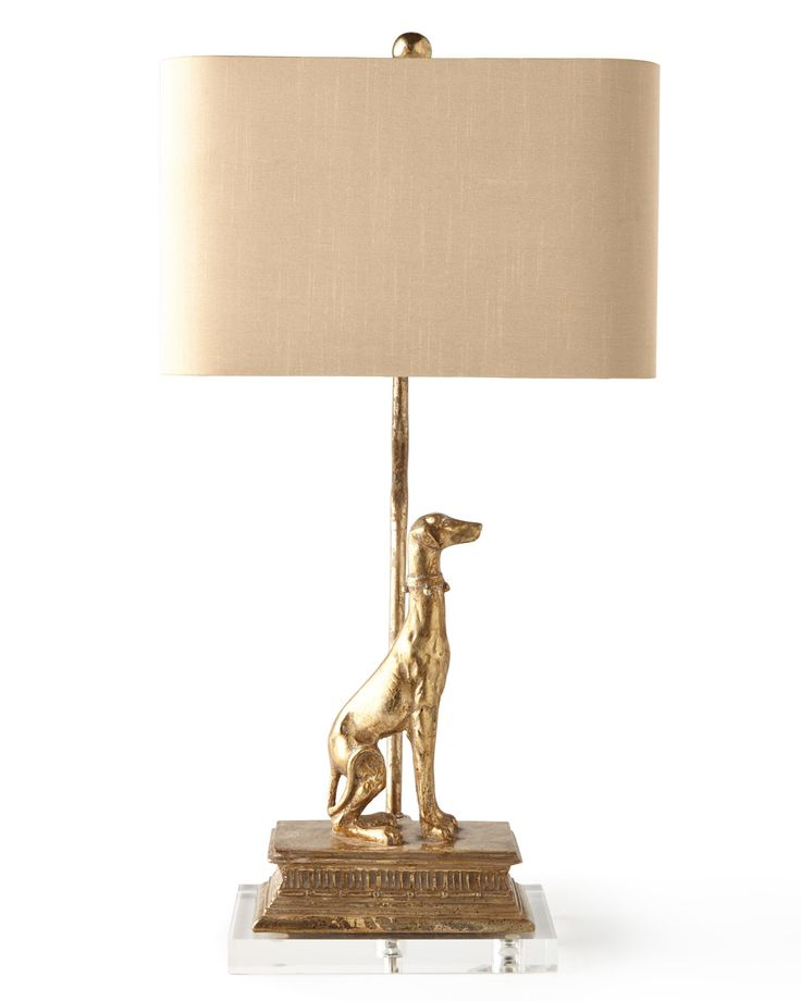 #ONLYATNM Only Here. Only Ours. Exclusively for You. Handcrafted greyhound-sculpture lamp. Resin with optic crystal base. Opulent silver finish. Silk rounded-corner rectangular shade with silver-foil