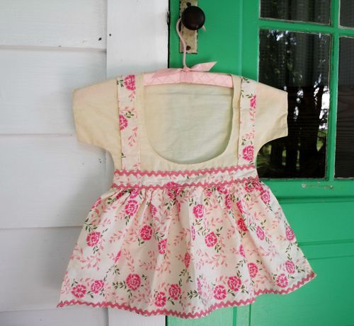 My mom had one that looked like a dress and I would play with it when she hung the laundry.  Sweet.