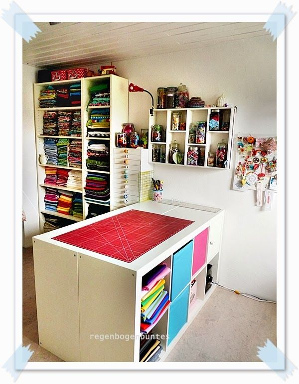 Like the idea of putting 2 cube shelves together back to back & then topping with a surface for a craft table.
