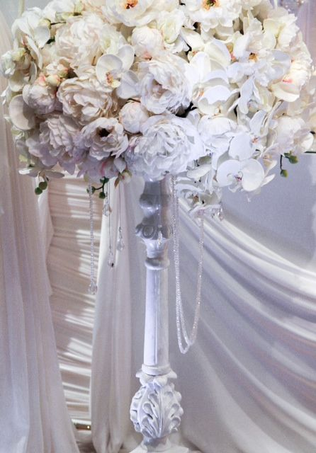 Our very elegant white timber carved candle stick holder used as a stunning Guest table centrepiece includes silk florals. Hire enquiries elanakweddings@hotmail.com