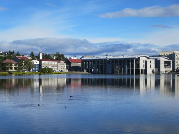 The Radhus (city hall) of Reykjavik, Iceland, stands at the north end of Tjornin lake.