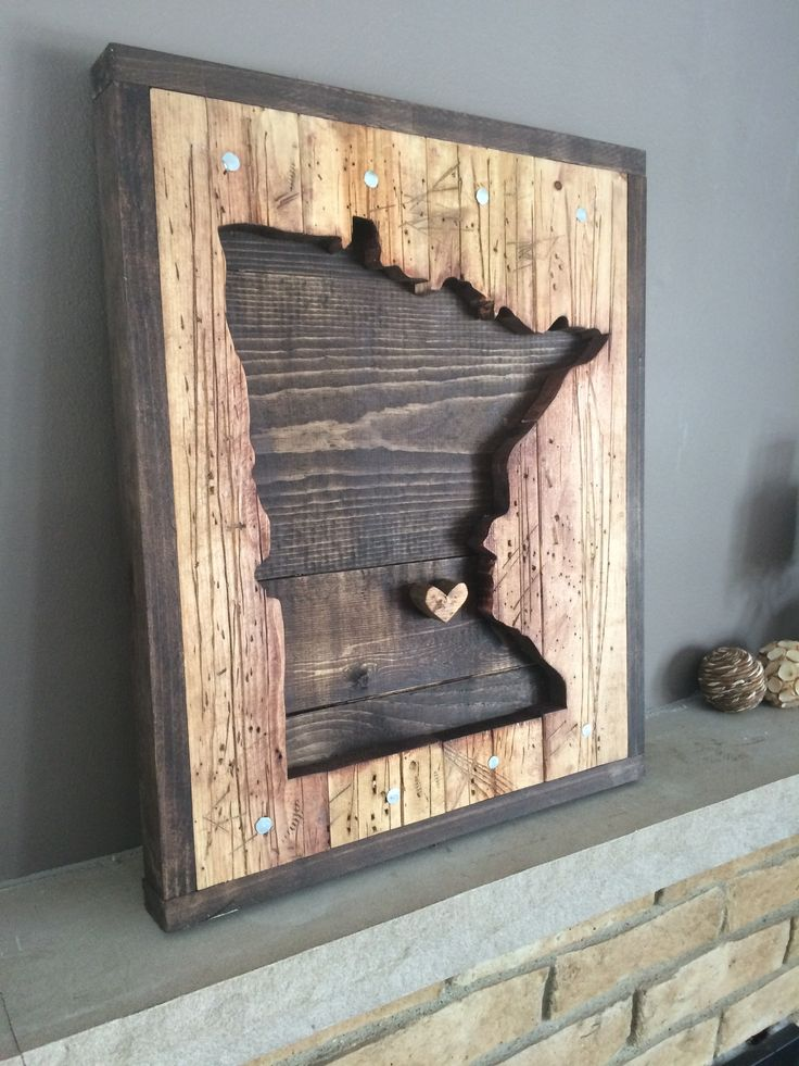 All of our work is handcrafted. The wood is cut, distressed, and then stained to create a beautiful piece of art that will be glorious in any space. We finish off the work with galvanized nails and a location marker in the place of your choice. The MN marker ( heart, circle, or star shaped ) can be moved to any area within the state. Each piece is individually made and its character is unique. This piece is a fantastic conversation starter, perfect for a cabin, and it works beautifully…