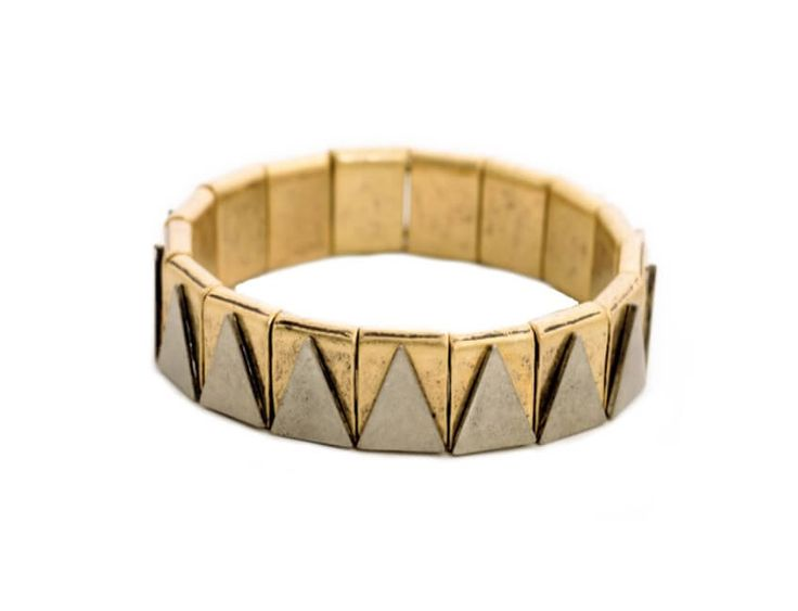 This stretch bracelet features silver metal triangles on antique gold beads. Wear this bracelet alone or pair it with an antique gold watch for a layered look.
