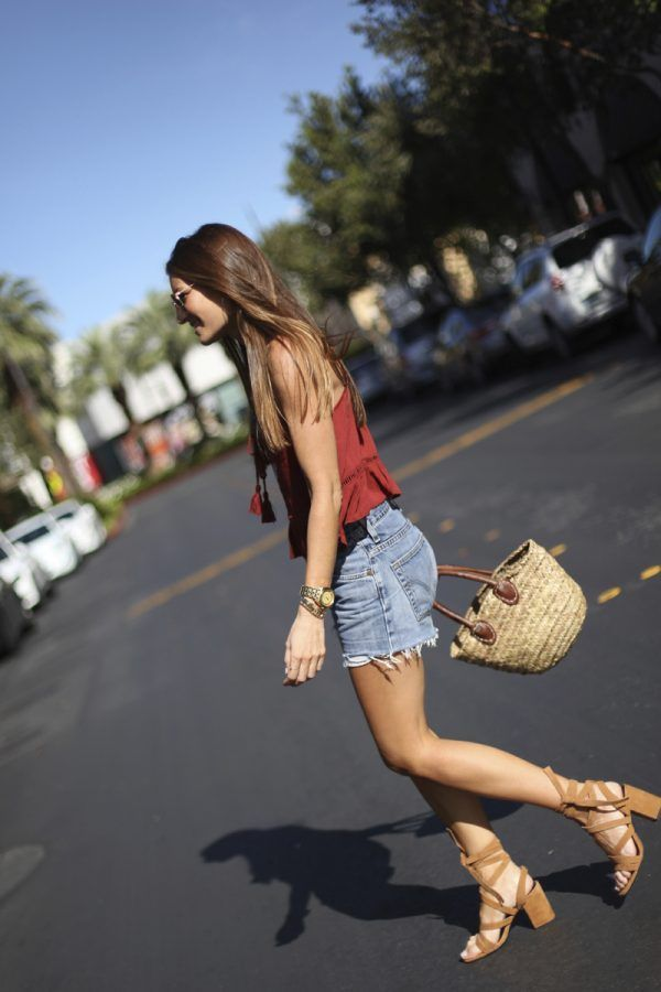Yet another super cute denim shorts style! This look is the perfect choice for either beach or city, and can be styled up with a pair of statement heels like this chunky pair from Senso. Via Silvia Garcia. Top: Forever 21, Shorts: Levi's, Sandals: Senso, Bracelets: Mango, Bag: from a flea market.
