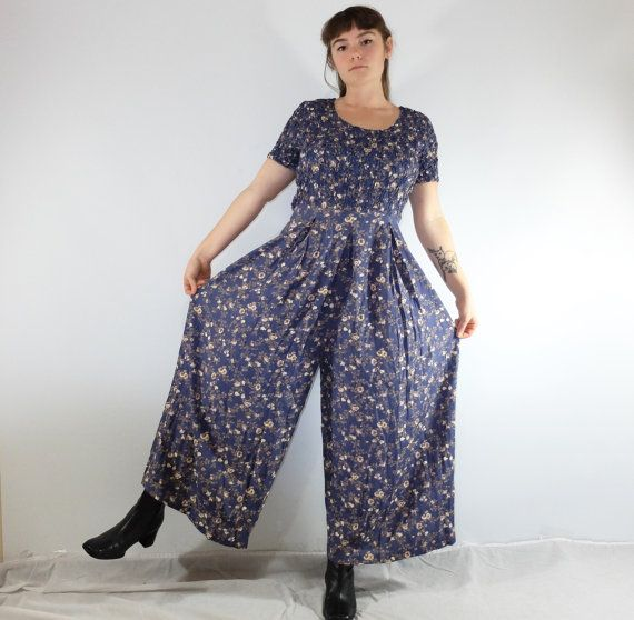 90s Mauve Floral Palazzo Pant Jumpsuit -super wide leg parachute pant bottoms -popcorn textured top -pretty floral pattern -so comfortable and breezy -in excellent condition Brand: Jeffery & Dara  Size: Large/XL Length 53 Waist 32 Pit to Pit 19  Message us with any questions you may have, thank you!    follow us on instagram! @threthreepigsvintage (http://www.online-instagram.com/user/threepigsvintage/2278199087)  _____________________________________________...