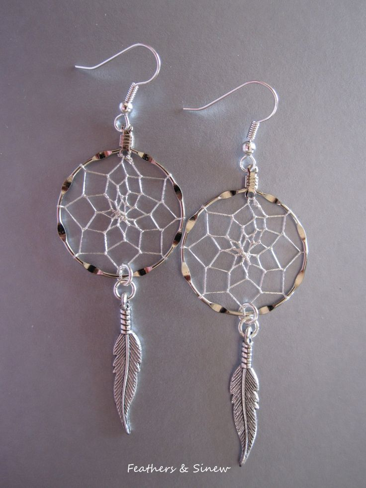 Dream Catcher Earrings ~ Silver with Antiqued Silver Feathers by FeathersandSinew on Etsy https://www.etsy.com/listing/188909603/dream-catcher-earrings-silver-with