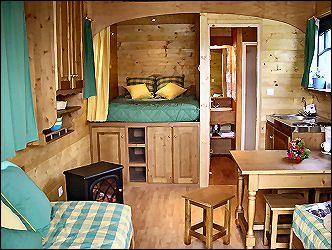 wonderful tiny house layout, very traditional.......finally a bed without the loft......I don't want to be climbing stairs and crawling to change the sheets
