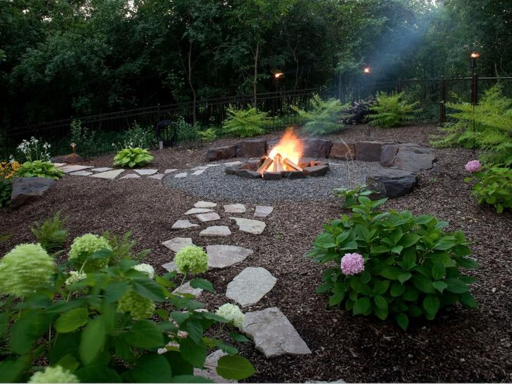 The arrangement of pavers can point people in the right direction in a yard. These stone pavers, installed by Southview Design, lead folks to a built-in fire pit near the edge of the woods on the Minnesota property.