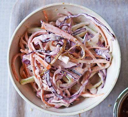 A simple homemade coleslaw of traditional carrots, onion, celery and both white and red cabbage with light mustard-lemon mayonnaise