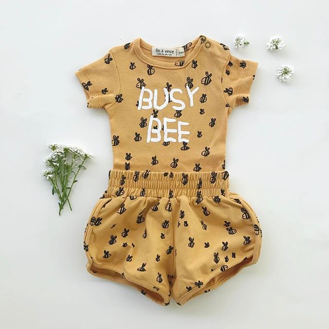 Organic baby and kids clothing. Made in the USA. Fin & Vince. Busy bee baby onesie, baby bee shorts