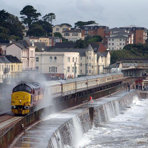 Dawlish, Devon, England UK . Train through the waves .