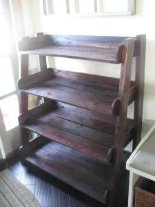 4-shelf unit made from pallets- great for displaying dishes, linens ect...