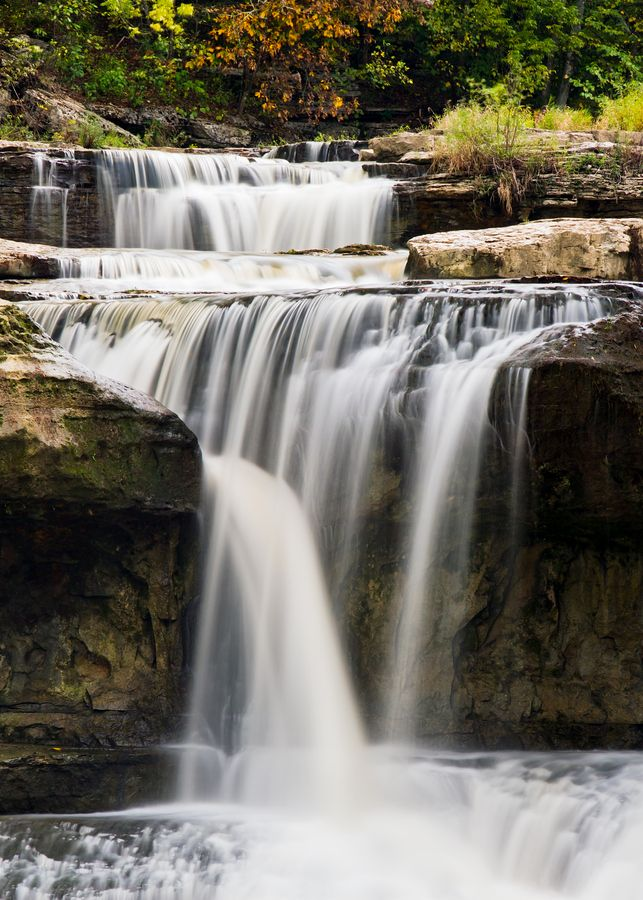 Water pours through boulders in Indiana's Upper Cataract Falls.  Cataract Falls, where two sets of falls on Mill Creek create a cascade that drops 86 feet, is the largest waterfall in Indiana.