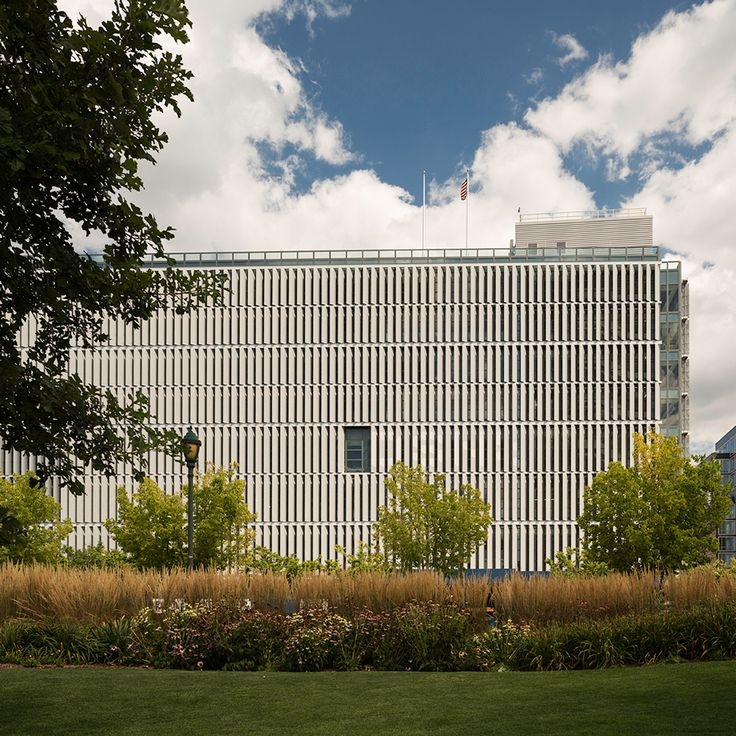 New York firms Dattner Architects and WXY have completed two buildings for the city's sanitation department: a rectilinear garage and a sculptural salt shed