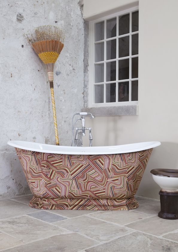 Our beautiful Galleon #CastIron #bath clad in Andrew Martin vita multicoloured fabric - beautiful and different - great for an eccentrically #decorated #home