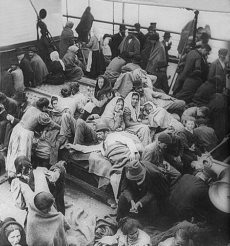 Immigrants arriving at Ellis Island, the LEGAL lawful way to enter America.