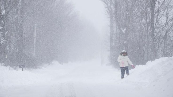 NEW MILFORD, PA - MARCH 14: A woman struggles down a rural road as snow in Northeast Pennsylvania reached two feet and still falling on March 14, 2017 in New Milford, Pennsylvania. A blizzard is forecast to bring more than a foot of snow and high winds to up to eight states in the Northeast region, as New York and New Jersey are under a state of emergency. School districts across the entire region were closed and thousands of flights were canceled. (Photo by Brett Carlsen/Getty Images)